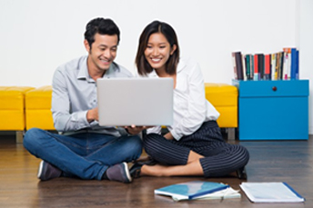 an Asian couple looking at laptop