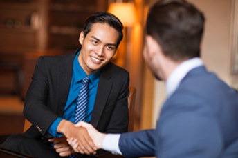 shaking hand during business meeting