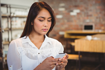 a girl using her smartphone in store